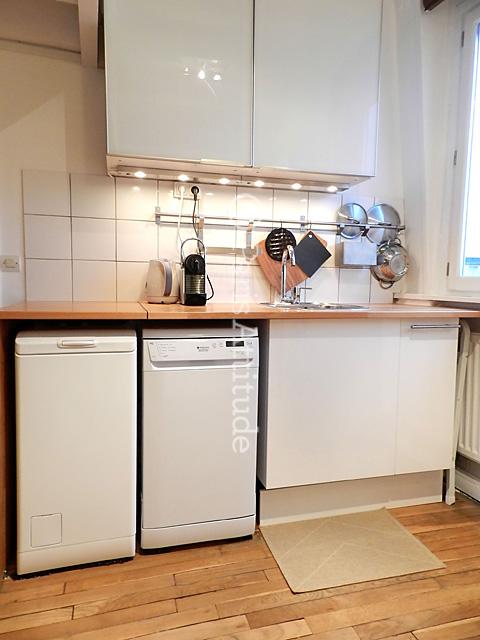 lave linge dans la cuisine 7 la cuisine ouverte est quip e avec un bar avec 2 chaises un. Black Bedroom Furniture Sets. Home Design Ideas